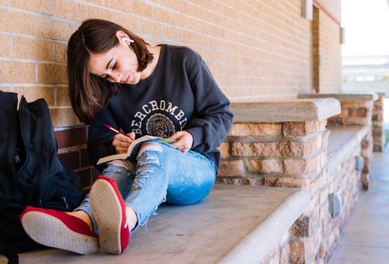 Teen writing sketching